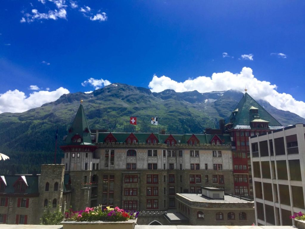 The Badrutt's Palace Hotel, on the background the Swiss Alps