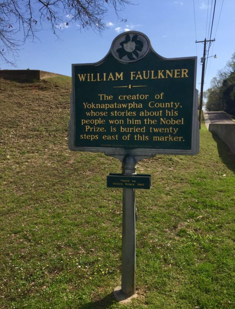 The notice indicating Faulkner's grave