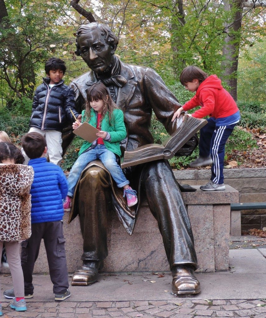 The Christian Andersen statue and its little fans