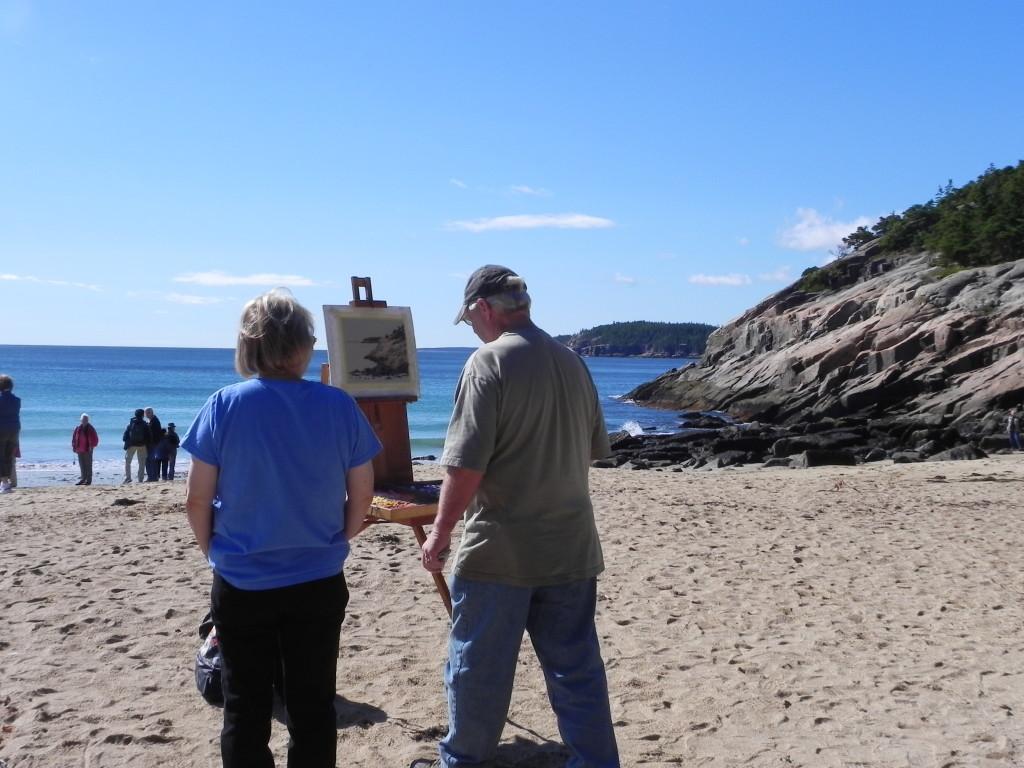 Artisti all'opera sulla spiaggia di Sand Beach